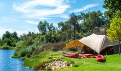 Tented pitched right on the Olifants River in Citrusdal. Photo by Melanie van Zyl Tent Camping, Campsite, Outdoor Gear, South Africa, Outdoor Furniture, River, Luxury, Holiday Ideas, Places