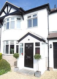 Entrance porch on semi-detached house with round bay windows- reminds me of my childhood. Porches can make a difference. Porch Uk, Front Door Porch, Porch Doors, Front Porch Design, House Front Door, House With Porch, House Entrance, Porch Designs, Front Porches