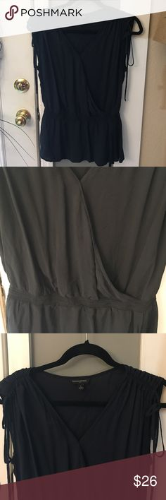 Banana Republic Black Drop Waist Top Excellent like new condition worn once or twice only. All rayon materials. Length about 27 inches and bust about 21 inches. Stretchy top, fits bigger for small. Sleeves have cute tie detail. Cute with jacket for the fall! Women's Banana Republic Tops Blouses