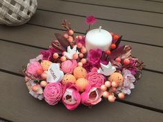 Pink-orange spring table decor with candle