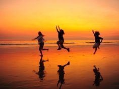 Silhouetted Children Playing on the Beach at Sunset