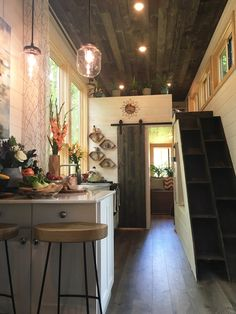 Inside the Ever Growing Tiny House are whitewashed pine tongue-and-groove walls, dark oak ceiling planks, and dark oak laminate flooring. Radiant floor heating keeps the house warm and comfortable in the winter.