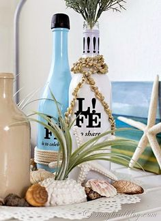 Seashell Vignette with decorative bottles: http://www.completely-coastal.com/2014/11/decorating-ideas-with-bottles.html