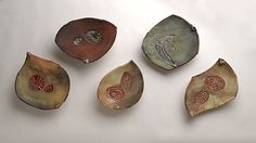 Intricately textured surfaces are glazed and contrasted with the beautiful natural markings from pit firing. Earthy colors. The bowls can be hung in any orientation, vertical, horizontal or grouping.