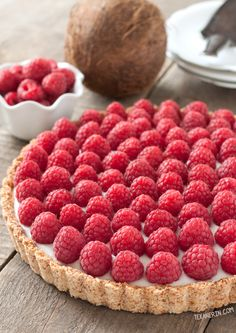 This raspberry coconut tart has a simple press-in coconut crust and coconut pudding filling! {paleo, vegan, grain-free, gluten-free, and dairy-free} @texanerin
