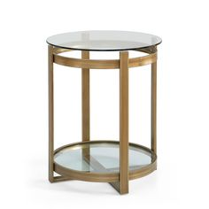 This Retro Glitz glass and metal end table is a throwback to the Hollywood glam days. Features a brushed goldtone finish and clear tempered glass top and shelf, this chic end table offers distinctive Hollywood glam era design.