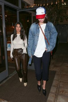 Little and large! Kendall Jenner towered over her older sister Kourtney Kardashian as they...