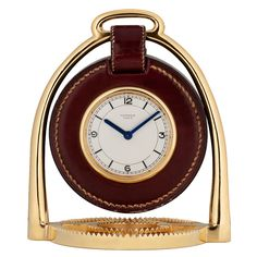 HERMES Gilt and Leather Framed Clock   CREATOR:     Hermes         COUNTRY:     Paris, France         CREATION DATE:     1940