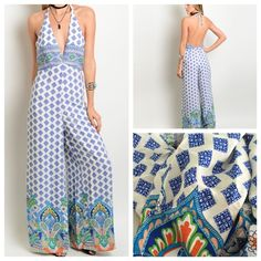 "Paisley Blue Jumpsuit Be on Trend this Summer with this Gorgeous Paisley Blue Jumpsuit. Colors are Cream, Blue and Green. Back Lower Zipper and Ties at Neck. Beautiful and Well Made this Jumpsuit. Bust is Lined and Overall Jumpsuit is not Too Shear. 100% Polyester. Length 60"". Available S/M/L. Retail Pants Jumpsuits & Rompers"