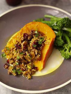 Baked Pumpkin stuffed with fruity and nutty rice. Recipe by Jamie Oliver. Great Fall food. Delicious! #vegan