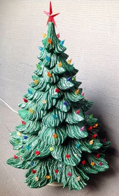 This lighted tree is beautiful and very large. From base to star it measures 24 tall and 16.5 in diameter. There is very minimal chipping