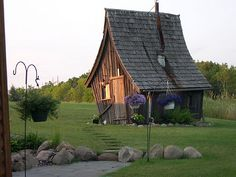 whimsical house by rustic way