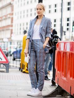 Quirk up your formal suit by teaming it with a pair of cool white sneakers and a basic tank top. You'll look street style cool, we promise!