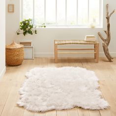Livio Large Faux Sheepskin Rug LA REDOUTE INTERIEURS Perfect for making bedrooms extra cosy or creating comfortable spaces in your living room, this fluffy rug add a luxurious touch to any home. White Shag Rug, White Rug, White Faux Fur Rug, Faux Sheepskin Rug, Fluffy Rug, Piece A Vivre, Striped Rug, Decorating Rooms, Homes
