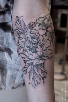 Flower/floral tattoo on the arm