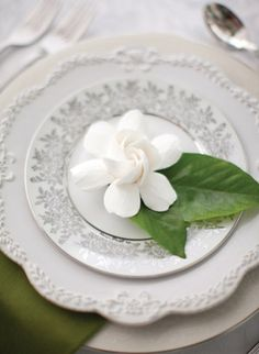 Southern Weddings Something Old, Something New « Southern Weddings Magazine. This is a gardenia, but we could do the same with magnolias.