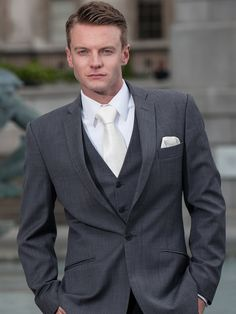 PEPPERS FORMAL WEASR   MONACO one button mid grey wool suit. With matching grey waistcoat, white business shirt and an ivory tie