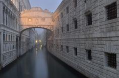 The Bridge of Sighs (by Csilla Zelko) in Venice is a white limestone bridge with stone bars on the window.