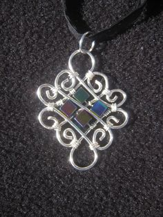 Pendant. Wire wrapped with Artistic Silver plated wire and Rainbow Hematite. $40.00.