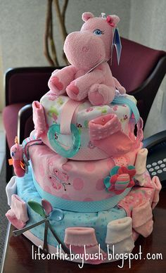 Diaper cake made with receiving blankets to look like a fondant cake