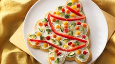 """For the ultimate appetizer """"wow,"""" serve this crescent tree topped with cream cheese and garnished with veggie garland and ornaments.  Holiday decorating never tasted so good!"""