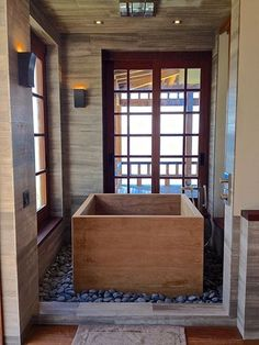 What if you could create an exotic getaway inside of your own home? Give your bathroom a tropical update. Limestone Tile around wooden bathtub.  Luxury Bathroom, Virgin Gorda, British Virgin Islands by Young Tile International.  #limestonetile #luxurybathroom