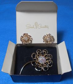 """1969 Boxed Sarah Coventry Gold Tone Aurora Borealis """"Allusion"""" Flower Brooch & Clip On Earrings Set"""