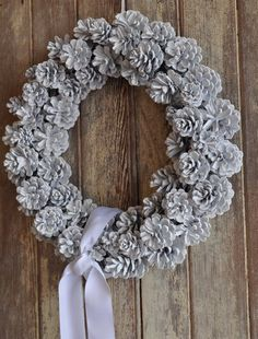 white pine cone wreath-BEAUTIFUL ON A BLACK DOOR