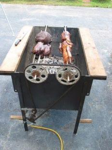 Grill - Homemade grill constructed from steel plate, angle iron, sprockets, chain, and an electric motor.