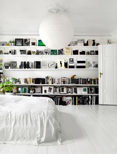 Love the white look of this bedroom and the way the shelves are organised