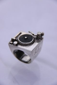 Rad ring! I have a friend who is a staunch advocate of vinyl. I keep this ring posted because it reminds me of her. Also, it's pretty cool. I wonder if the parts move?
