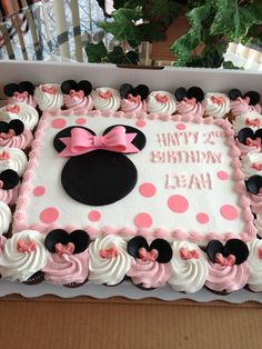 Minnie Mouse Cake!! After not wanting to spend a fortune on a minnie mouse cake, this is what we did. Cake/cupcakes, large bow and icing by SAM's Club, fondant ears and bow decorations by Me!! Turned out adorable! #birthdaycakes