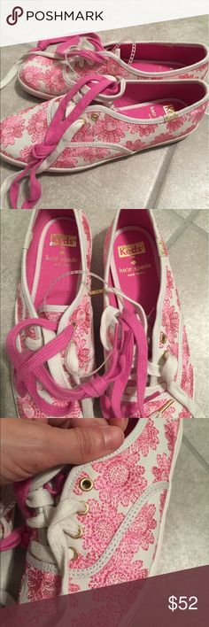 NWOT Kate spade keds tennis shoes New ! No box . Pink flower print . White and pink size 6 never wore gold trim where the shoe laces go . Two sets of laces for them , one is pink and the other is white .. back of the heel has minor spot where the gold trade mark for Kate spade is on the left foot shoes . Never worn .. no trades or low ball offers on them kate spade Shoes Flats & Loafers