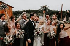 Nothing is more exciting to see than a bridal party that knows how to have fun! | Image by Melissa Marshall Photography