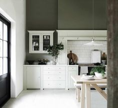 White kitchen with green wall