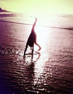My niece Talia doing cartwheels at the beach