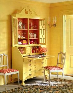 The amazing Eddie Ross painted the desk in glossy yellow, then papered the inside with a raspberry-tinted faux bois paper pop!