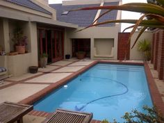 4 bedroom House for sale in Mossel Bay This is what you call HOME. With lots of space, this is an entertainers dream. Living areas flowing out onto the pool on the one side, and a sheltered courtyard on the other side. WEB REF: 4 Bedroom House, Pool Ideas, The Other Side, Living Area, Entertaining, Space, Outdoor Decor, Home, Floor Space