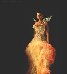 (Click on pic to see GIF) Cinna has turned me into a Mockingjay.