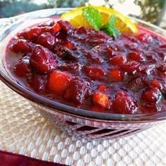 Fresh and dried cranberries cook with cranberry juice and orange flavors for a bright, jewel-like cranberry sauce they'll all be talking about. Serve it in a beautiful glass dish or compote.
