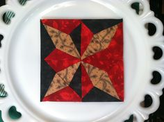 Block # 18 - Century of Progress, difficult block to piece to keep the points sharp, but I love this block, the contrast of the red and green, I think this block would make an awesome Christmas quilt.