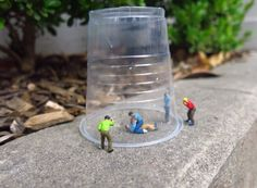 Little people scene: Trapped, distressed teenagers under plastic cup