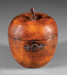 An English Apple-Form Tea Caddy, 18th c., with cut steel escutcheon, interior retains traces of foil lining, height 5 in.