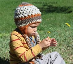 Crochet Toddler Braided Earflap Beanie  So cute and colorful this earflap beanie hat will keep your little one warm, cozy and stylish! The puff stitches give the hat some nice texture detail while the colors make it interesting and sweet and will match a lot of outfits. This is a great pattern for a … … Continue reading →