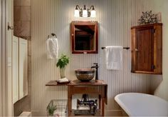 a sewing table that was transformed into a vanity. The Murano vessel sink from Thompson Traders and a long-neck faucet from Delta Victorian add some height. Vertical beadboard walls and swinging shower doors