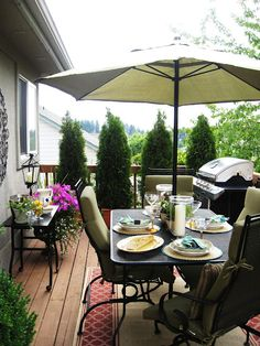 Love the potted trees/shrubs on the deck and the outdoor rug under the table