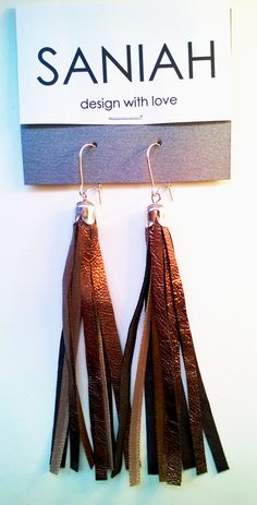 Bronze! Hapsu earring with black leather with shining bronze finishing and satin ribbons. Made of industrial surplus and recycled materials.