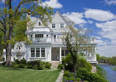 Built in 1900, this beautiful house sits on 1.16 acres on scenic Kirby Pond in Rye, New York.