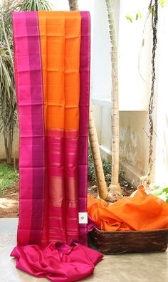 VIBRANT ORANGE HAS STRIKING MAGENTA AND PINK WITH A DASH OF GOLD BORDER AND PALLU GIVES THE SAREE DELICATE LOOK.