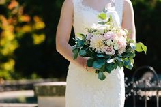 Unique fall wedding bouquet - pastel pink dahlias and roses surrounded by eucalyptus {Studio Phrené}